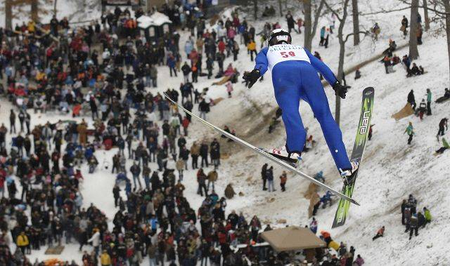 Anders Stenslokken, of Norway, is airborne over the crowd during his jump on the K70 hill at the Norge Ski Club international tournament in Fox River Grove Sunday.