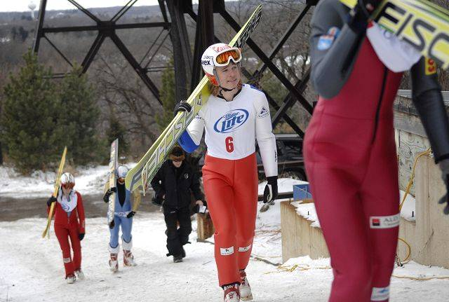Cooper Dodds of New York makes his way to the staircase of the K70 hill at the Norge Ski Club international tournament in Fox River Grove Sunday. They day before, he set a record by jumping 80 meters.