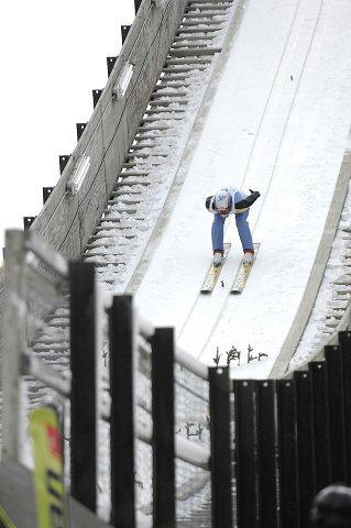 Elizabeth Wallace of St. Paul, Minn. comes down the K70 hill at the Norge Ski Club international tournament in Fox River Grove Sunday.