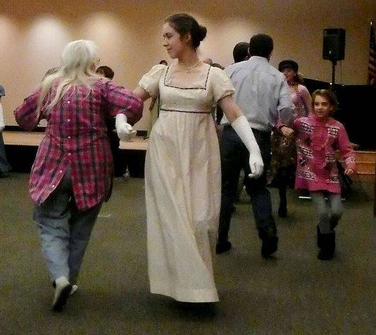 Elizabeth Bretscher, right, dances with Ann Rothmaler of Elgin in an English country dance performance and lesson Sunday at the Gail Borden Public Library in Elgin. The event was organized by the library's Jane Austen Fan Club.