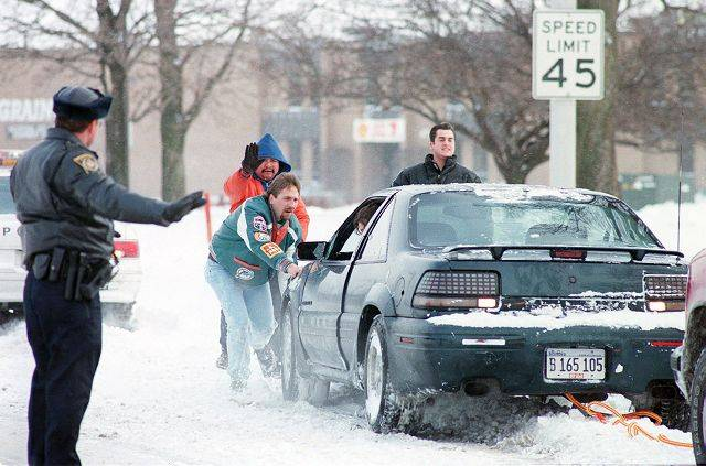 Pushing out a car in Rolling Meadows during the blizzard of 1999.