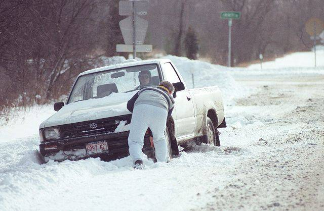 Pushing a truck out of a ditch in Lake County during the blizzard of 1999.