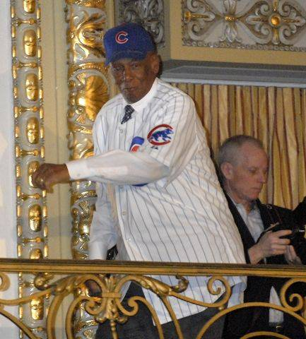 Mr. Cub Ernie Banks hams it up during his introduction on first day of a Cubs convention.