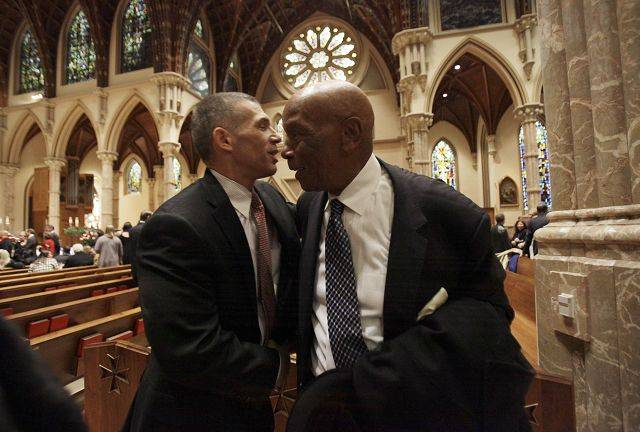 New York Yankees manager Joe Girardi, left, hugs Chicago Cubs great Ernie Banks during the visitation for Chicago Cubs great and longtime radio announcer Ron Santo at Holy Name Cathedral, Thursday, Dec. 9, 2010, in Chicago.