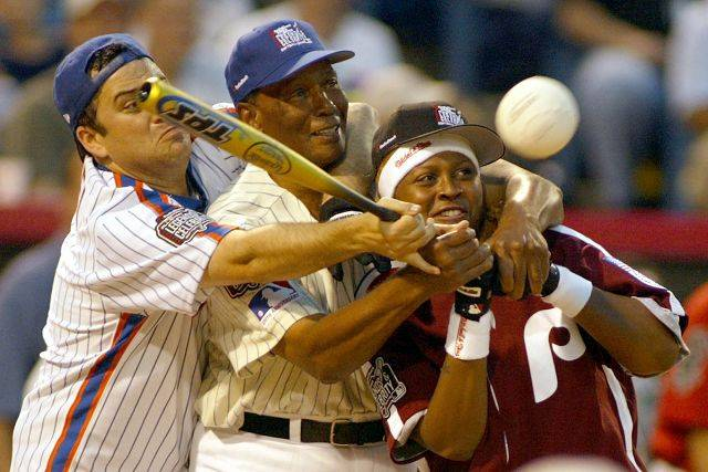 Jimmy Kimmel,left, and Ernie Banks help Ms Jade hit the ball during the Legends all-star game at U.S. Celluar Field in 2003.