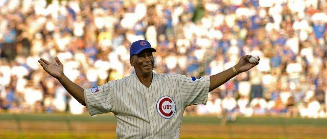 Cubs Hall-of-Famer Ernie Banks takes in the cheers of the crowd before throwing out the first pitch for game 3 of the divisional playoffs in Chicago in 2008.