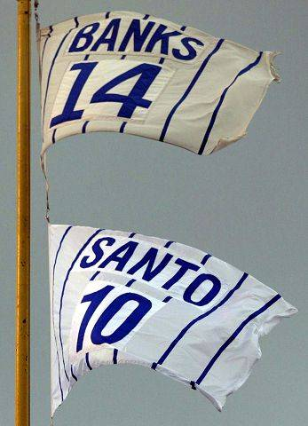 Ron Santo's #10 and Ernie Banks' #14 flap in the breeze high above left field in Wrigley Field as the Cubs complete the regular season against the Pirates in 2003.