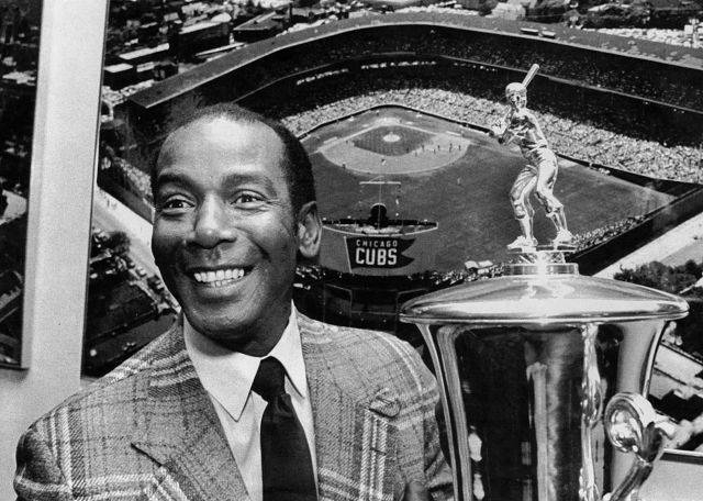 Ernie Banks shows off one of his trophies. He was voted into the Hall of Fame in 1977.