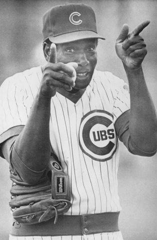"Ernie Banks, known as ""Mr. Cub"" points at Chicago Cubs fans during a training session at Mesa, Arizona on January 24, 1985."