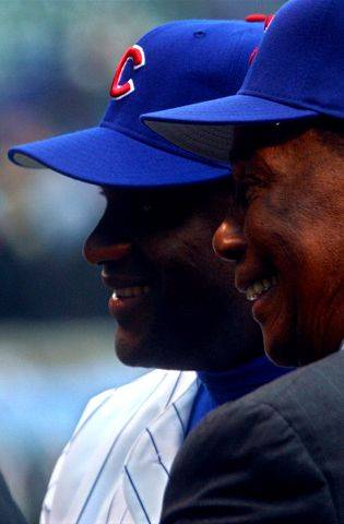 Cubs legend Ernie Banks, right, and Sammy Sosa acknowledge the crowd as they are introduced by Steve Stone as the club's 500 home run club on Opening Day 2003.