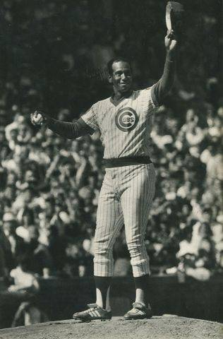 "Ernie Banks, known as ""Mr. Cub"", throws out the first pitch in the Chicago Cubs vs. San Diego Padres playoff opener on October 3, 1984 in Chicago at Wrigley Field. He was in uniform because he was an honorary member of the Cubs that day."