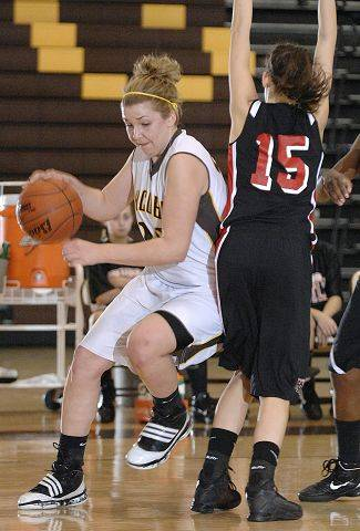 Jacobs' Melanie Schwerdtmann drives for the hoop around Huntley's Cecilia Tsevas during Wednesday's game.