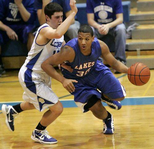 Lakes' Direll Clark, right, drives on Vernon Hills' Chris Argianas during boys basketball action Wednesday night in Vernon Hills.