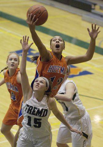 Hoffman Estates' Jada Stotts leaps for a rebound and draws a foul for going over the back of Fremd's Jaimie Groot during Tuesday's game.