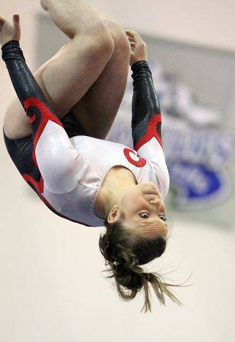 Mundelein's Emily Tylka competes on the beam at the North Suburban Conference girls gymnastics meet at Vernon Hills on Friday.