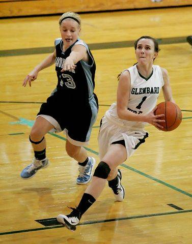 Willowbrook's Jessica Nolan, left, defends as Glenbard West's Bridget Flanagan drives to the basket Tuesday in Glen Ellyn.
