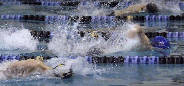 St. Charles North's Andrew Preusse takes a quick lead in the 50-yard freestyle event against Metea Valley Tuesday.