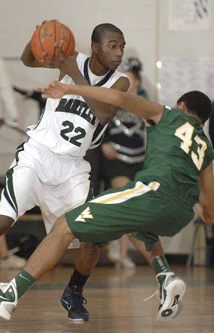 Bartlett's Femi Oyewole drives past Waubonsie Valley's Brandon Malby who falls to the floor Tuesday.