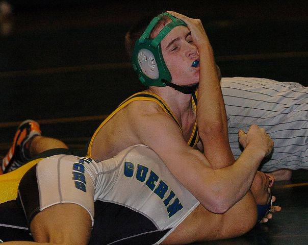 Alex Mertes, top, of Elk Grove winning over Will Torres of Guerin in the 119-pound match at Elk Grove Wednesday.