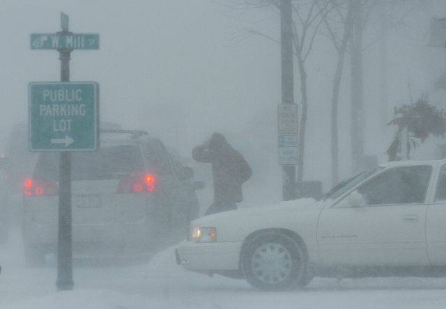 A motorist makes her way to her car in downtown Wauconda.