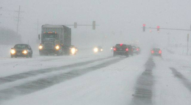 Low visibility on Butterfield Road after snow started coming down with high winds Tuesday afternoon in Wheaton.