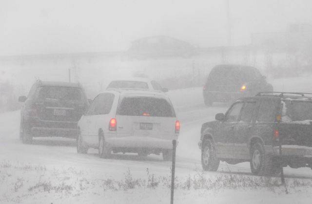 Traffic backs up on the on ramp at Arlington Heights Road to I-90 as the blizzard begins Friday afternoon in Arlington Heights.