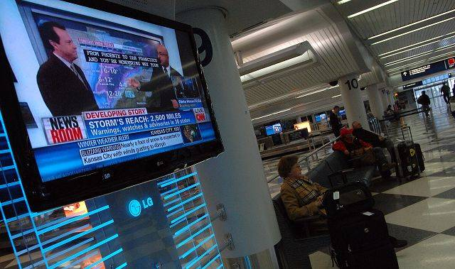 All passengers can do is sit and wait out the storm as the local news flashes the latest information on the TV in baggage claim.