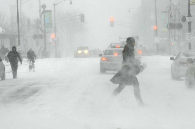 Pedestrians didn't fare much better than drivers as the blizzard begins in full force Tuesday afternoon in downtown Arlington Heights.