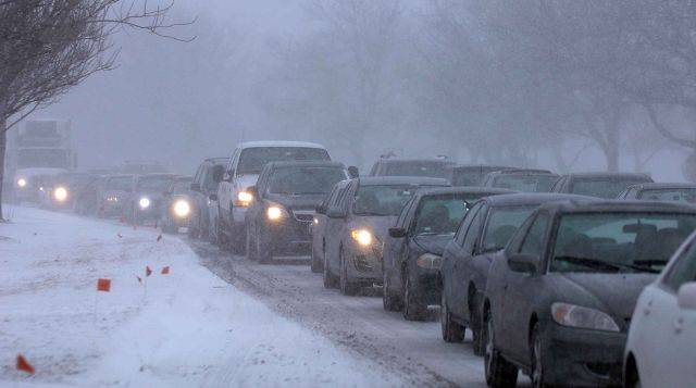 Cars are bumper to bumper along route 59 in Naperville Tuesday woith nearly white out conditions.