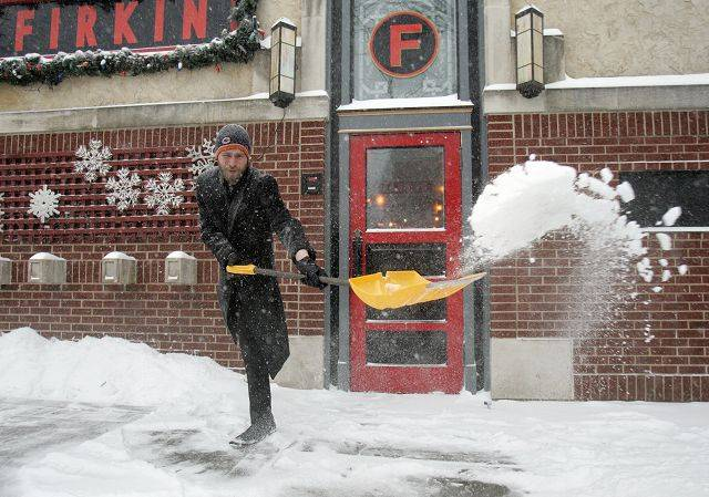 Travis Kick, a manager at the Firkin Restaurant, gets a head start on shoveling as a blizzard hit the area Tuesday afternoon in Libertyville.