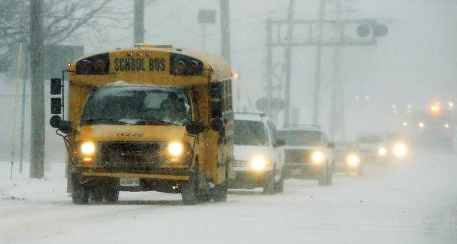 A Mundelei school bus makes its way along Hawley Street in Mundelin Tuesday afternoon as a blizzrd hit Lake County.