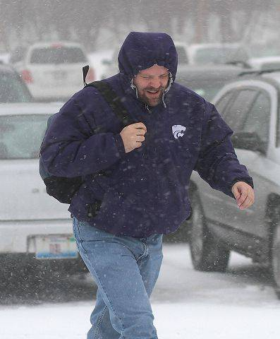 A commuter makes his way to the train as a blizzard hit the area Tuesday afternoon in Libertyville.