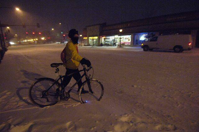 Don Jessen of Mt. Prospect gets ready to ride 2.3 miles home on his bike from the Mt. Prospect train station during Tuesday's blizzard. He says he rides his bike every day, regardless of the weather.