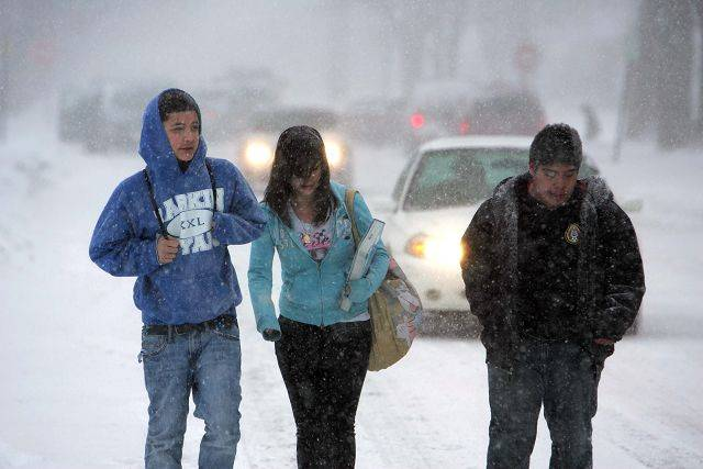 Emmanuel Alejandres, from left, Liseth Leal, and Fernando Perez brave the blizzard as snow hits the Fox Valley area Tuesday, February 1, 2011. The Larkin High School students were trying to make their way home.