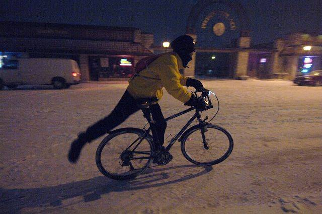 Don Jessen of Mt. Prospect begins the 2.3 mile ride home on his bike from the Mt. Prospect train station during Tuesday's blizzard. He says he rides his bike every day, regardless of the weather.