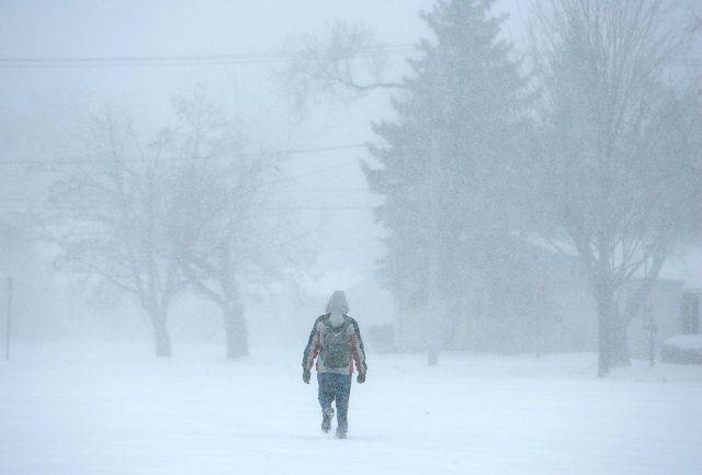 Snow hits the Fox Valley area Tuesday, February 1, 2011 as Larkin High School students make their way home.