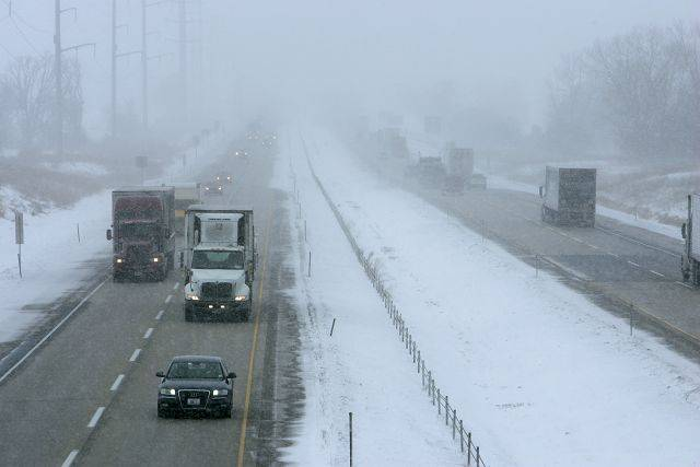 Looking West from Powers road in Gilberts as Snow falls along Interstate 90 Tuesday, February 1, 2011. Increased snowfall will make travel difficult, with blizzard like weather predicted later today and Wednesday.
