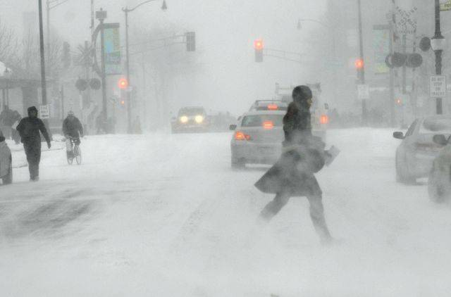 Pedestrians don't fare much better than drivers as the blizzard begins in full force Tuesday afternoon in downtown Arlington Heights.