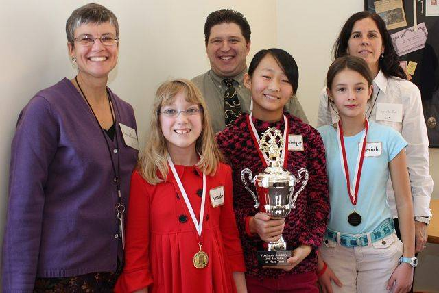 Lake Forest Country Day School students Amanda Tibbals, Dominique Hance, and Mariah Goeks proudly accept their first-place trophy from the Woodlands Academy Mathalon. Also pictured are Vicki Brown, Rocco Gargiulo, and Jennifer Yost, members of the Woodlands Academy Math Department.
