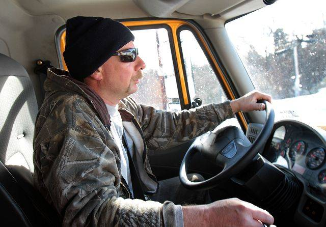STEVE LUNDY/slundy@dailyherald.com Veteran snowplow driver Dan Merz of the Lake County Division of Transportation drives his route the day after one of the worst winter storms in Lake County history.