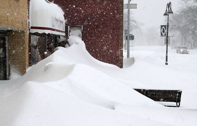 Shops on Glenview Road were buried in five-foot drifts in Glenview Wednesday.
