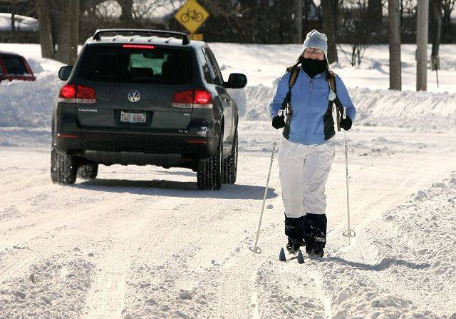 Marie Larsson of Libertyville cross-country skis down Brainerd Ave. in Libertyville Wednesday morning.