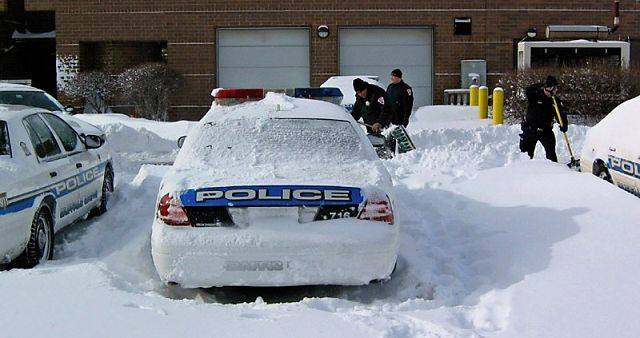 Buffalo Grove police were busy digging out squad cars after the snow tapered Wednesday morning.