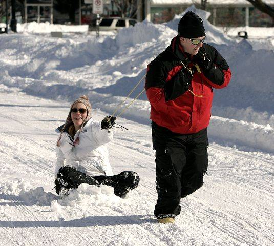 Michael Link of Evanston pulls Rachel McLinden, 14, of Libertyville on a sled down Cook Ave. in Libertyville Wednesday.