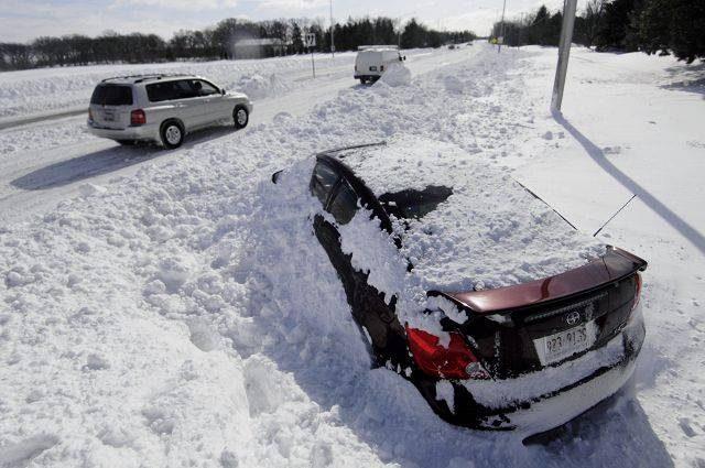 An abandoned car in the southbound lanes of Kirk Road in Geneva. The blizzard of 2011 left a number of cars stranded along Kirk Road between Tyler Avenue and Route 38.
