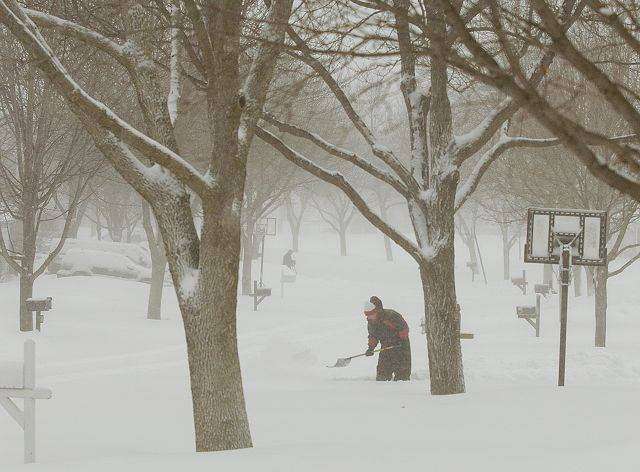 Mark Scalia starts the process of clearing his driveway in St. Charles Wednesday morning, as the Chicago region can once again boast about being weather tough.