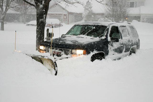 John Wilson of Lake Villa clears driveways along Huntington Drive in Mundelein Wednesday morning.