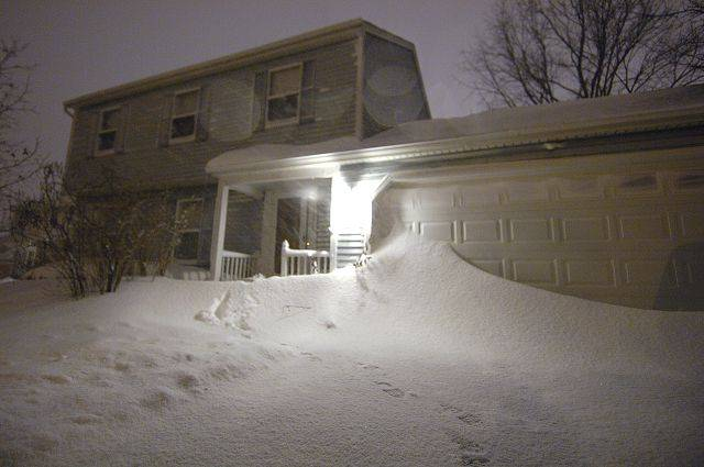 Four-foot drifts block garage doors at homes in St. Charles early Wednesday morning.