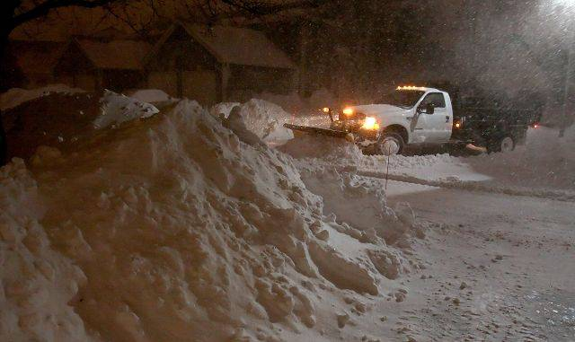Plows dig out from the blizzard in Aurora Wednesday morning.