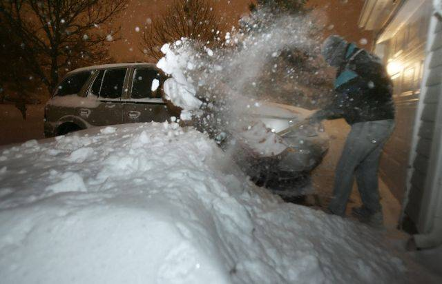 Steve Kern of Mundelein tries to dig his car out Wednesday morning after the blizzard pounded the area.